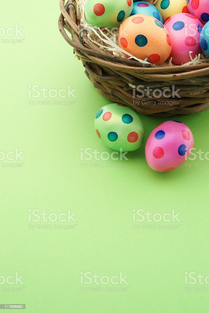 A basket of colorful polka dot Easter eggs royalty-free stock photo