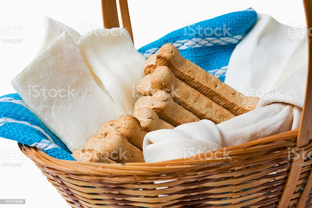 Basket of Dog Biscuits with Rawhide Strips and Bone stock photo