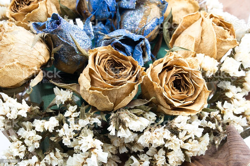 Basket of dried rose flower, isolated on white background royalty-free stock photo