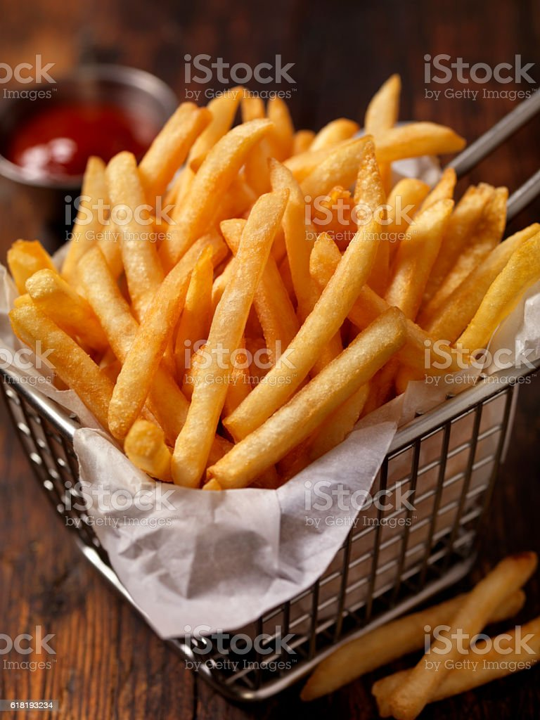 Basket of Famous Fast Food French Fries stock photo