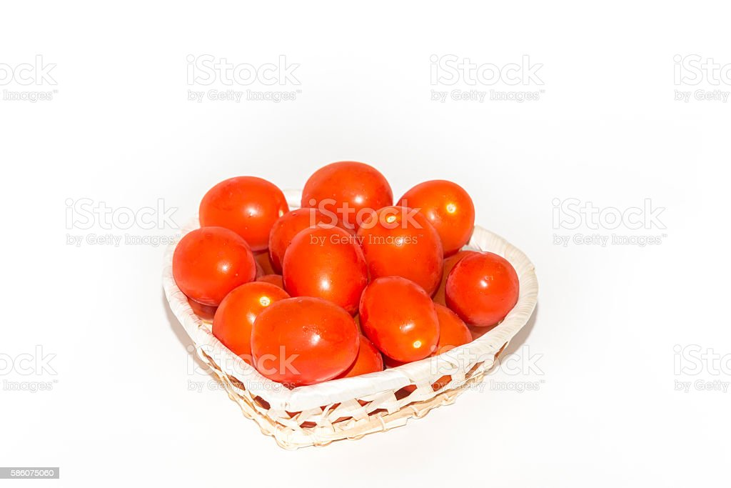 Basket of fresh red tomatoes,  isolated on white stock photo