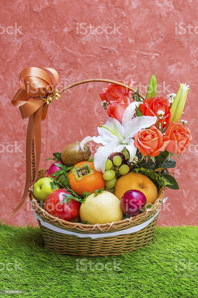 Basket of fruit and flower stock photo