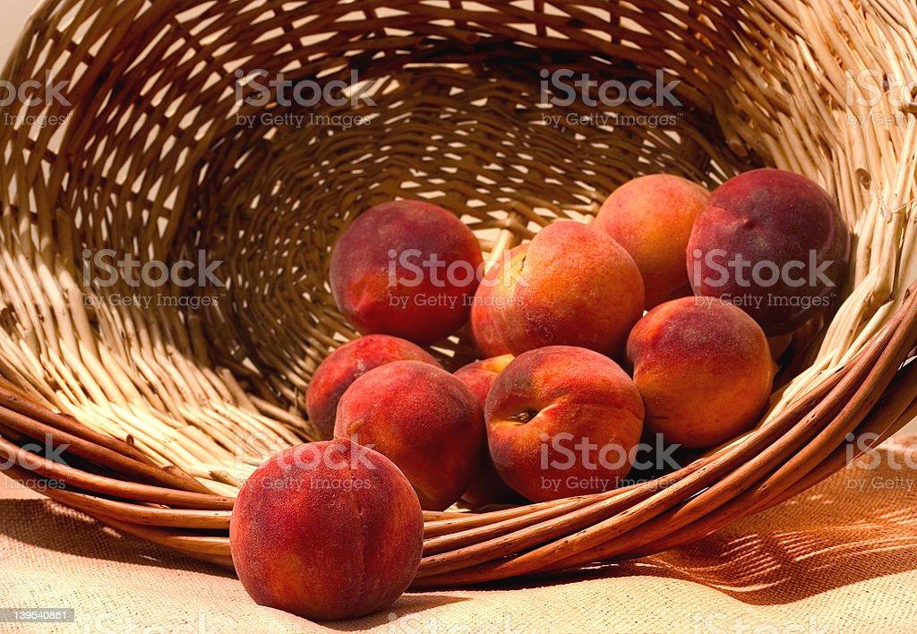 basket of golden peaches royalty-free stock photo