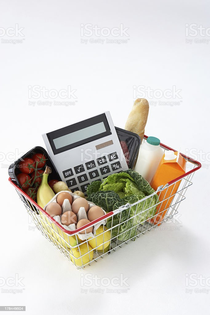 Basket of groceries and calculator stock photo