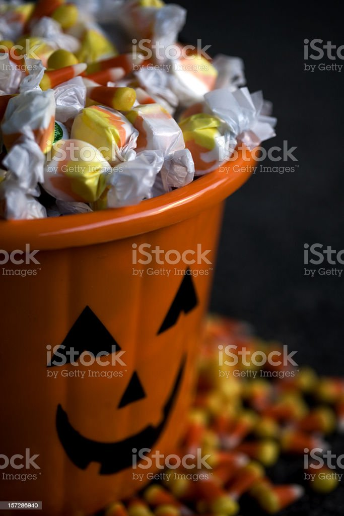 Basket of Halloween Candy Overflowing, Close Up stock photo