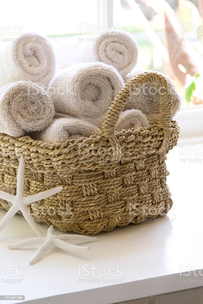 Basket of hand towels and star fish royalty-free stock photo