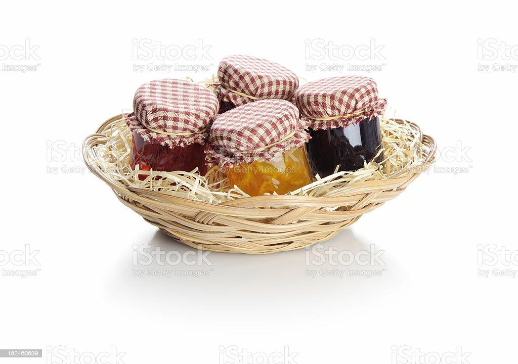 Basket of homemade fruit jams royalty-free stock photo