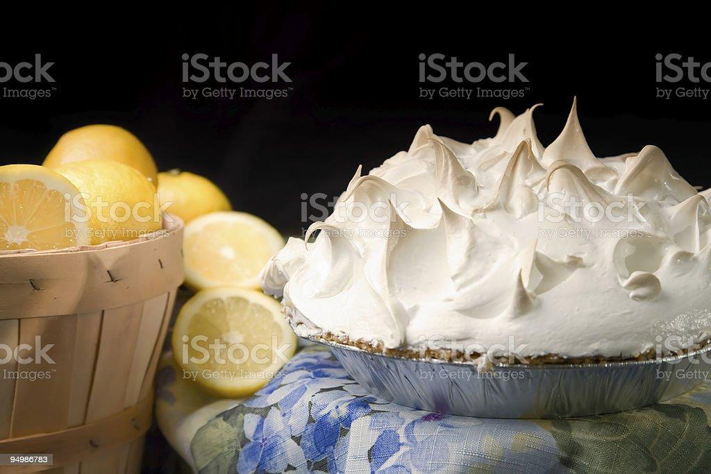 Basket of lemons with lemon meringue pie. stock photo