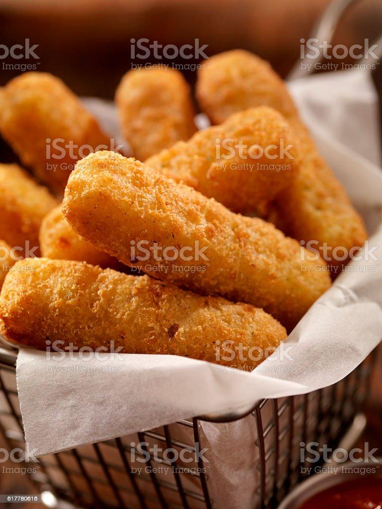 Basket of Mozzarella Cheese Sticks stock photo