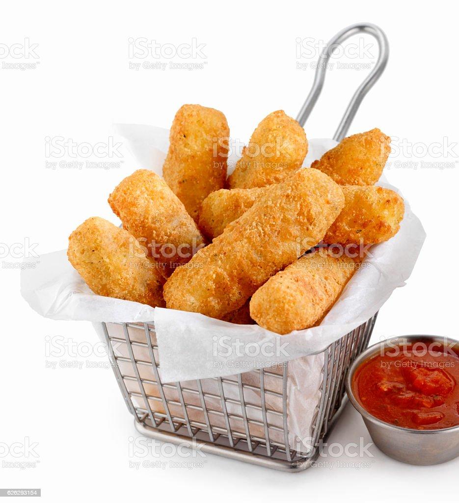 Basket of Mozzarella Cheese Sticks with Marinara Sauce stock photo