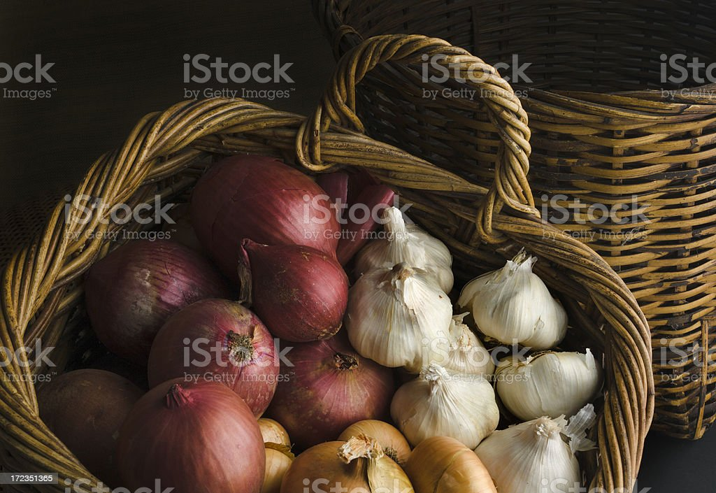 Basket of Onions and Garlics royalty-free stock photo