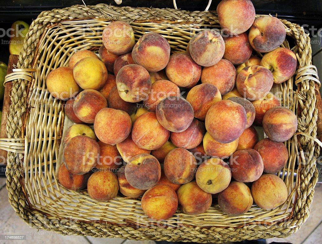 Basket of Peaches stock photo