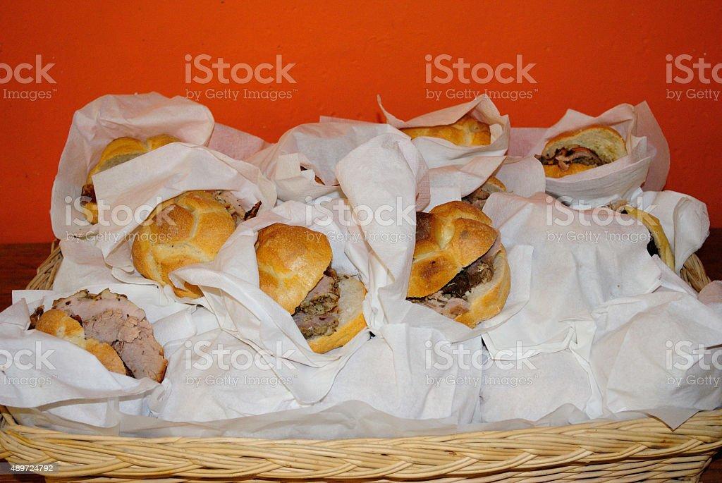 basket of porchetta's sandwiches stock photo