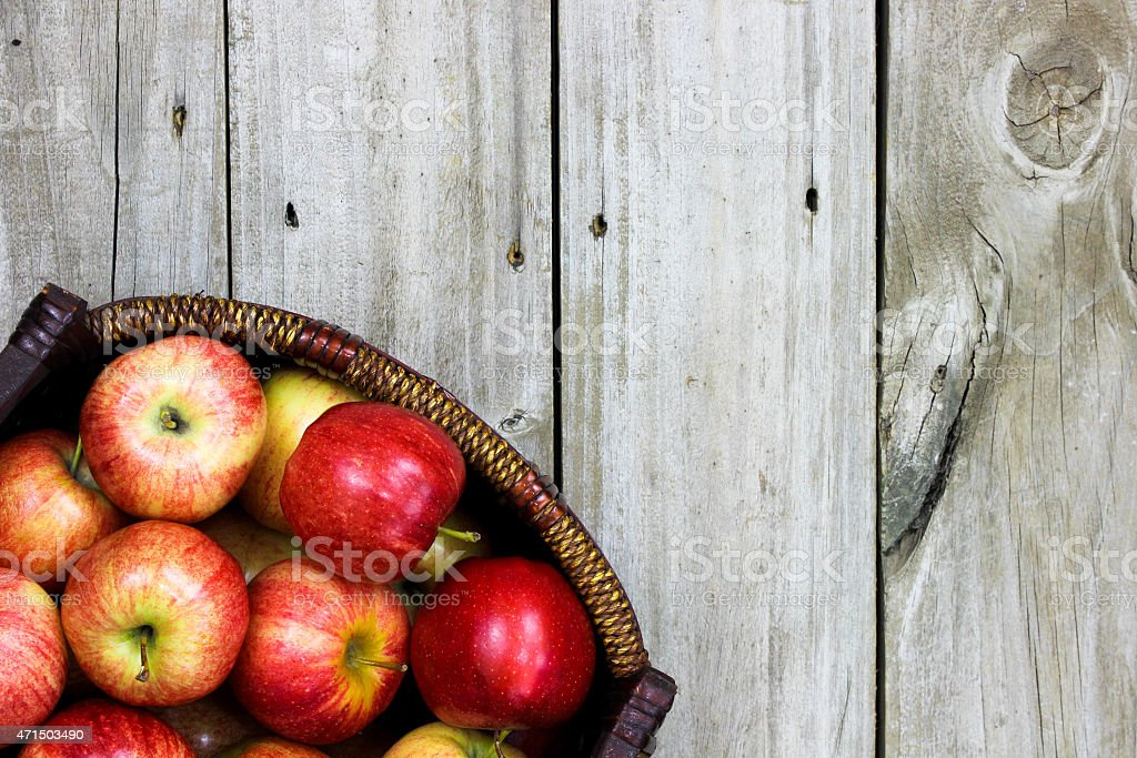 Basket of red gala apples on wooden table stock photo