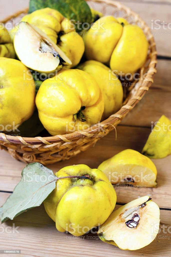 Basket of ripe yellow quince fruits stock photo