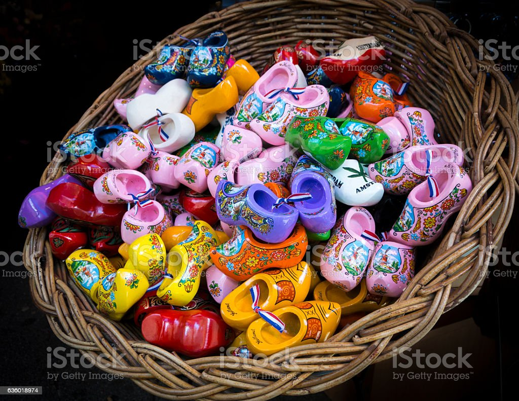 Basket of Small Colourful Painted Wooden Clogs stock photo