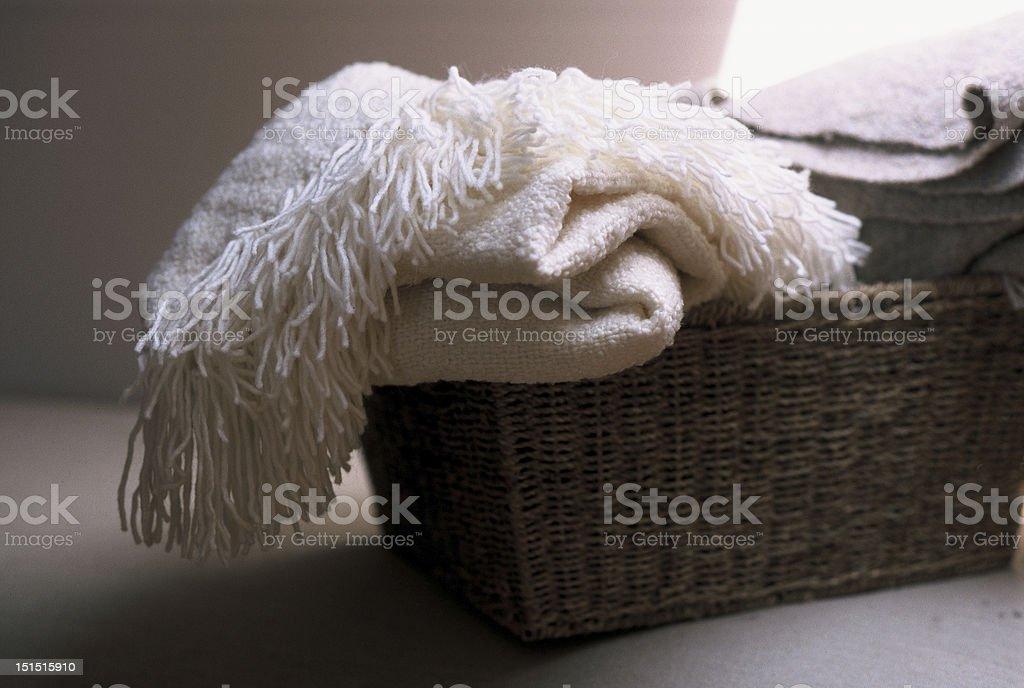 Basket of throw rugs royalty-free stock photo