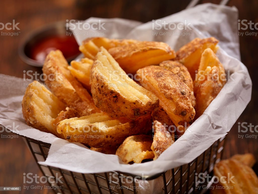 Basket of Wedge Fries stock photo