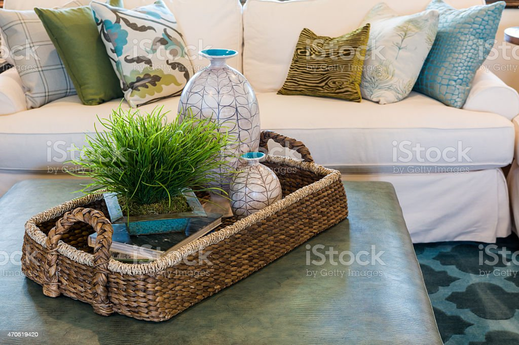A basket on a table in a living room, by a white couch stock photo