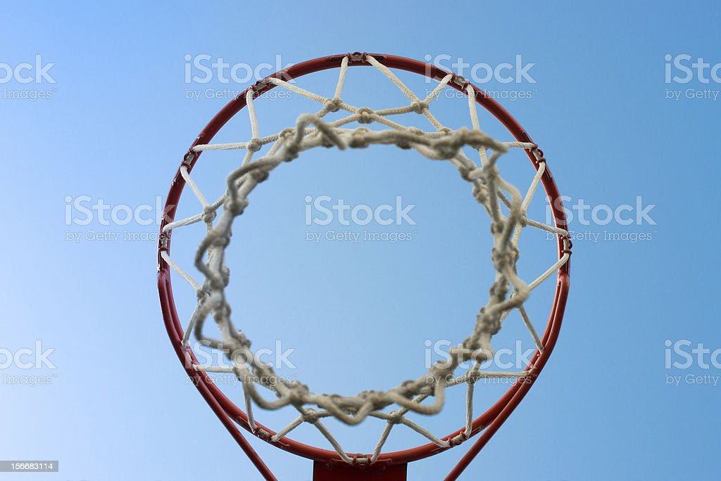 basket rim and net on a blue sky royalty-free stock photo
