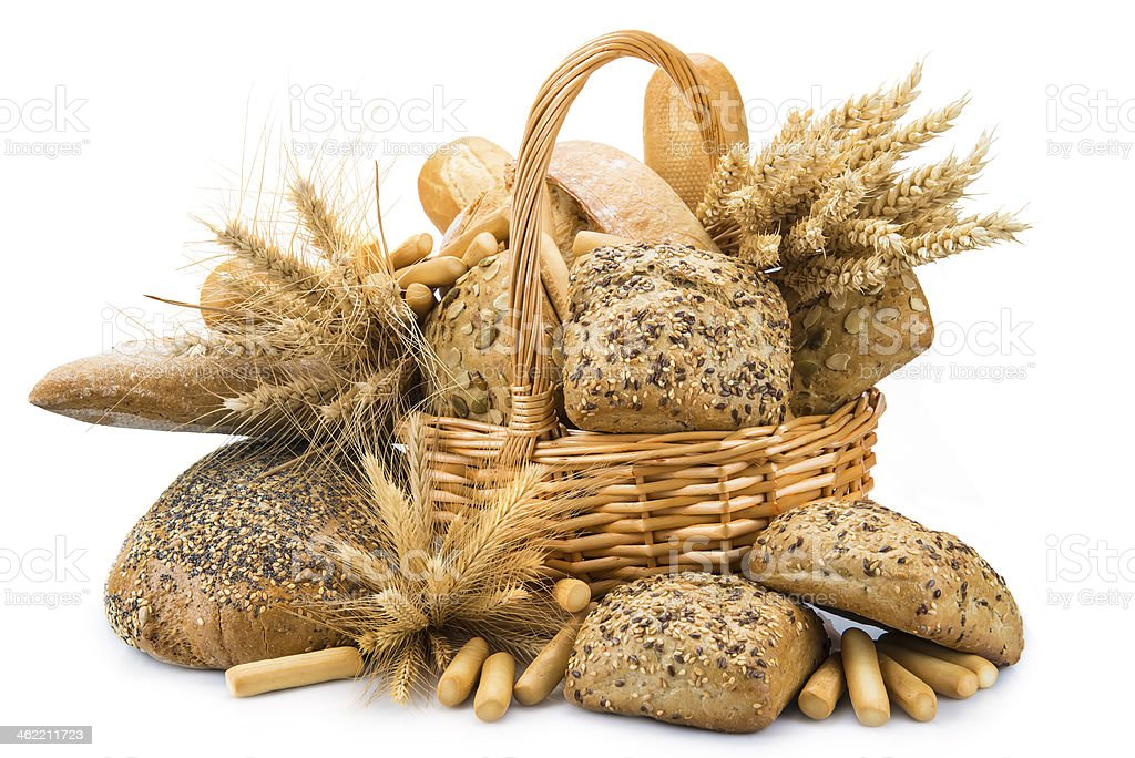 Basket with a bread assortment isolated on white stock photo