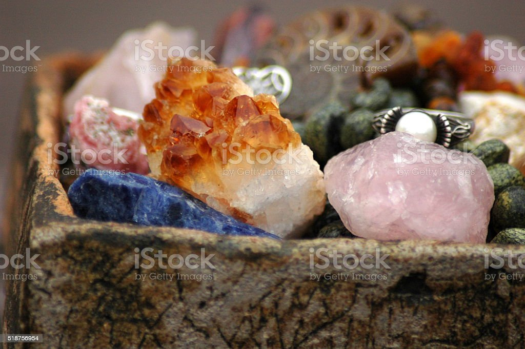 Basket with a lot of natural stones stock photo