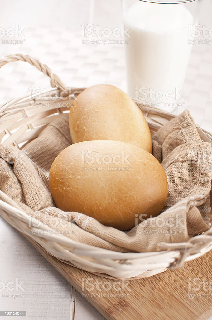 Basket with baked buns and milk royalty-free stock photo