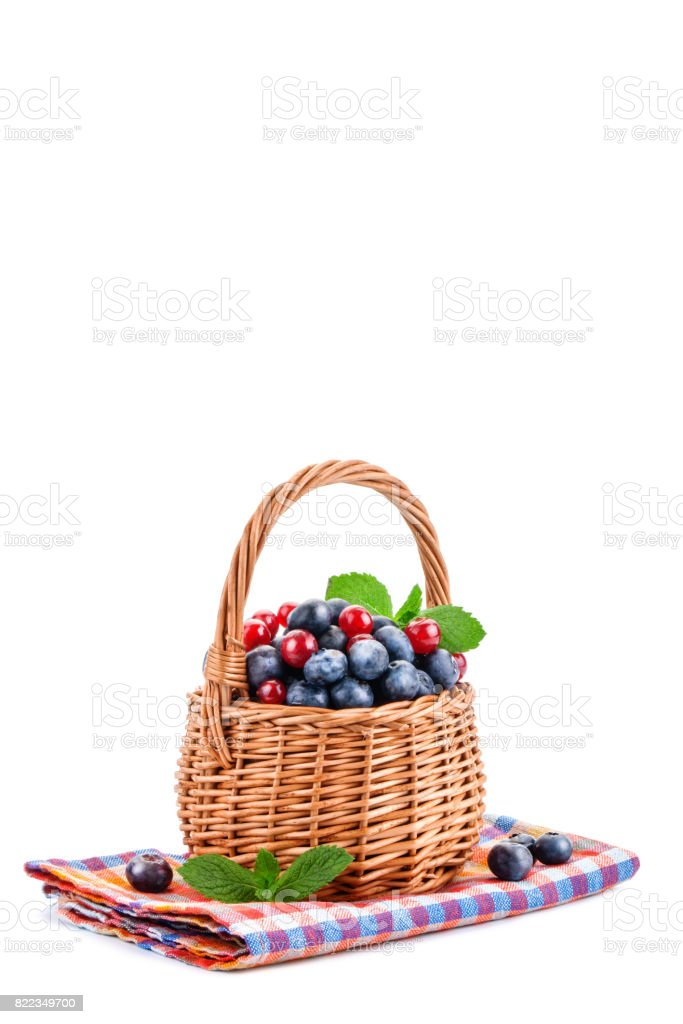 Basket with blueberries and red currants isolated on white background stock photo