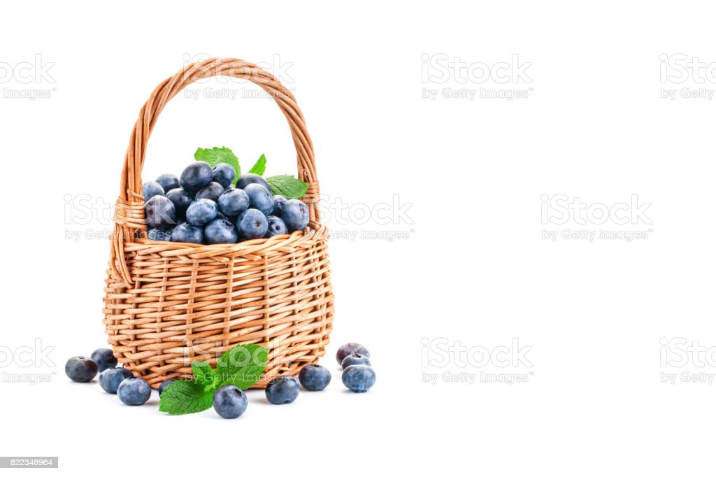 Basket with blueberries isolated on white background stock photo