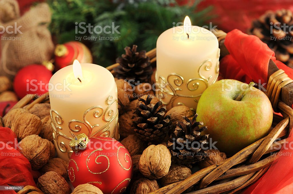 Basket with Christmas Candles and pine tree on red tablecloth royalty-free stock photo