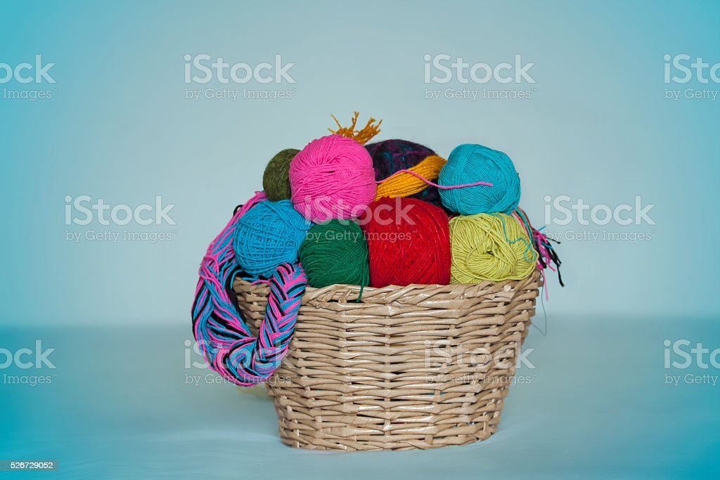 basket with colored woolen threads for knitting stock photo
