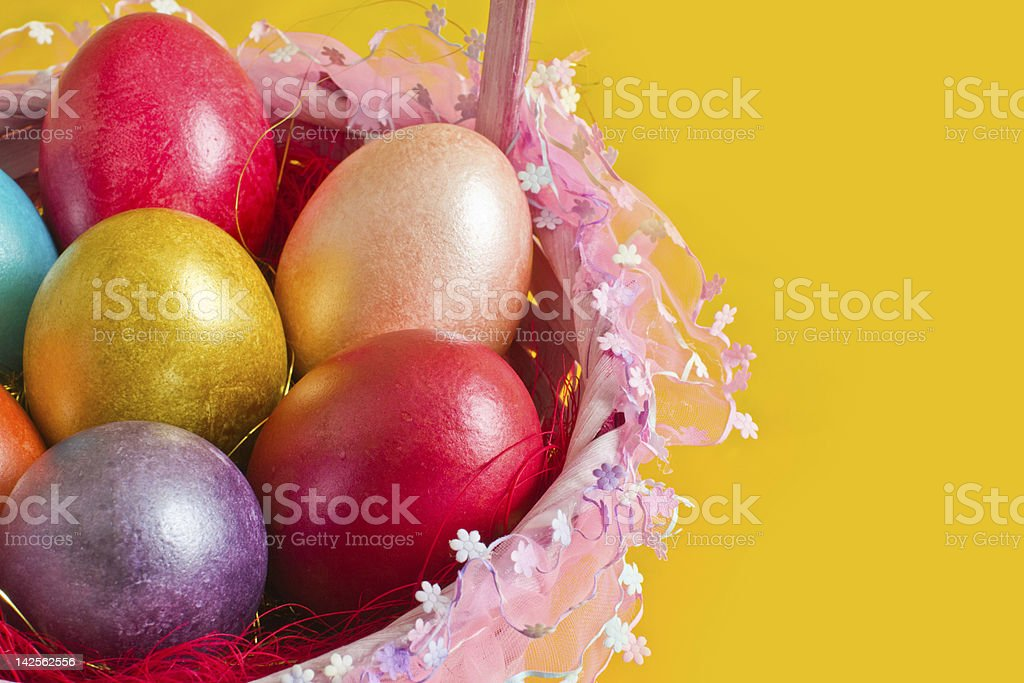 Basket with colorful easter eggs royalty-free stock photo