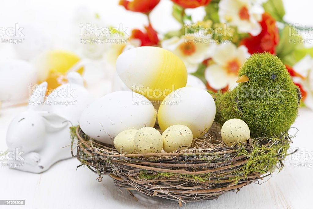 basket with easter eggs and rabbits, close-up stock photo