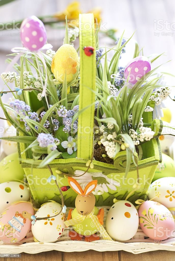 Basket with eggs, flowers and Easter bunny royalty-free stock photo