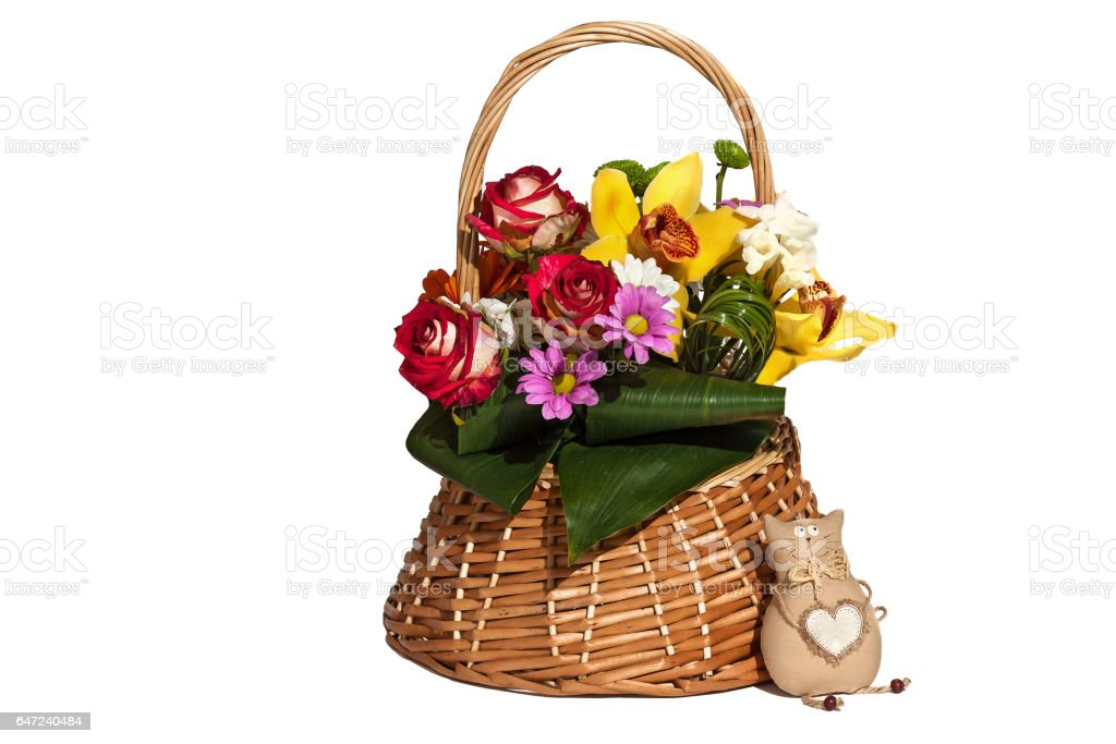 Basket with flowers and toy stock photo