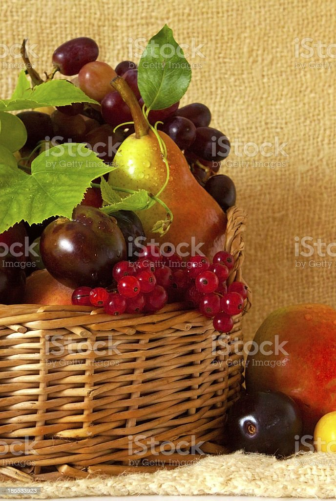 Basket with fresh fruits royalty-free stock photo