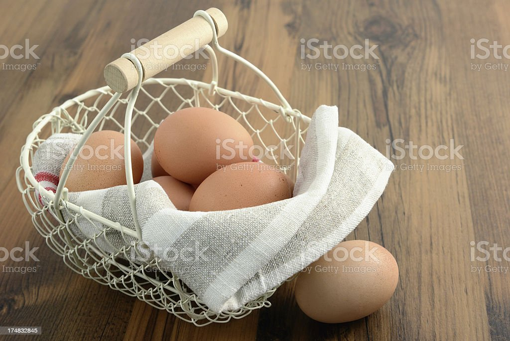 basket with natural beige eggs on table royalty-free stock photo