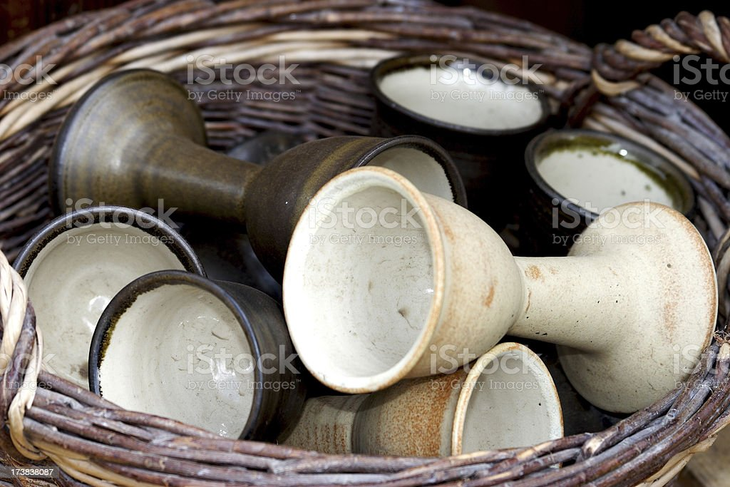 Basket with old drinking cups royalty-free stock photo