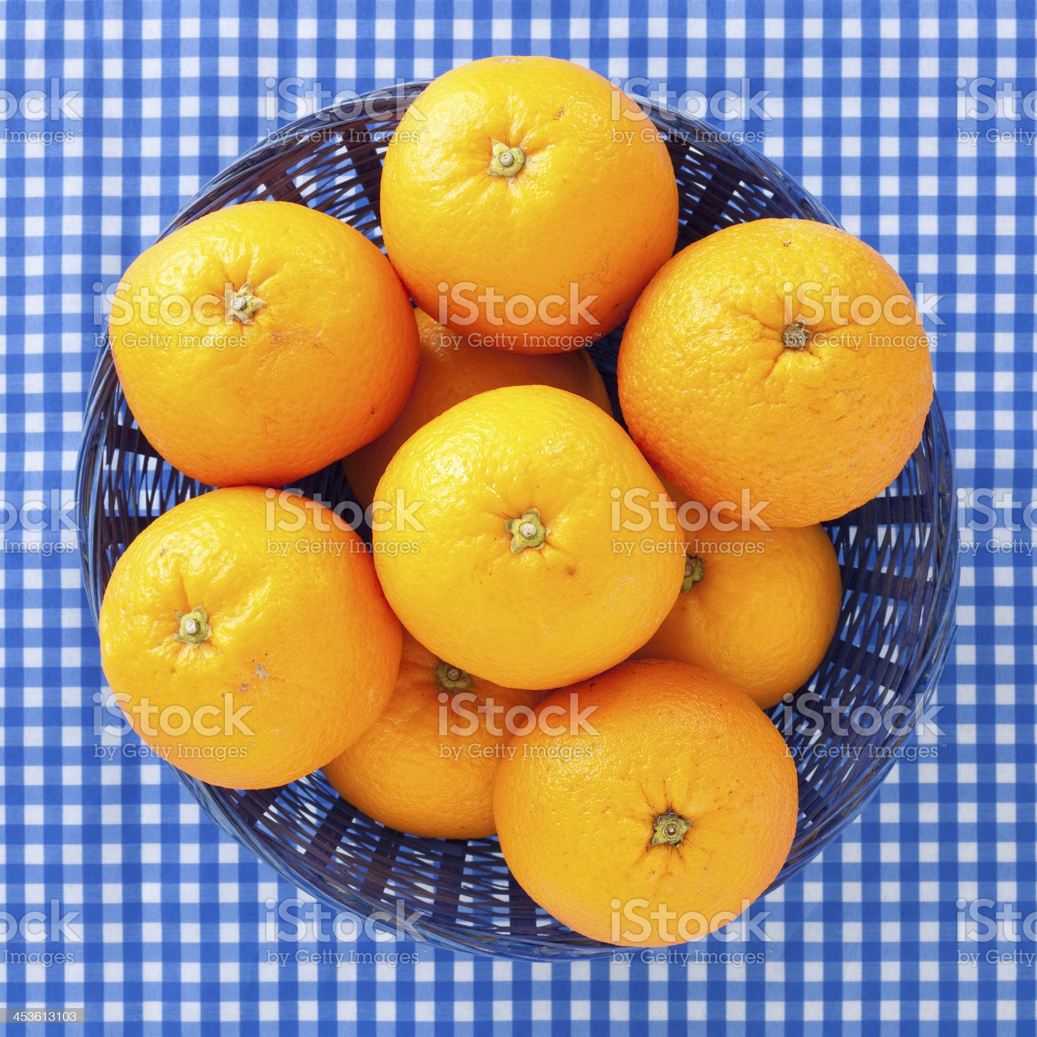 Basket with oranges royalty-free stock photo