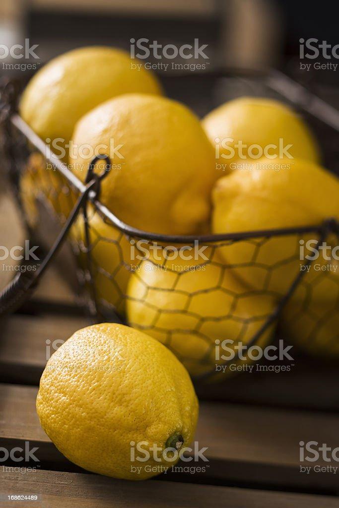Basket with Organic Lemons Fresh From Market royalty-free stock photo