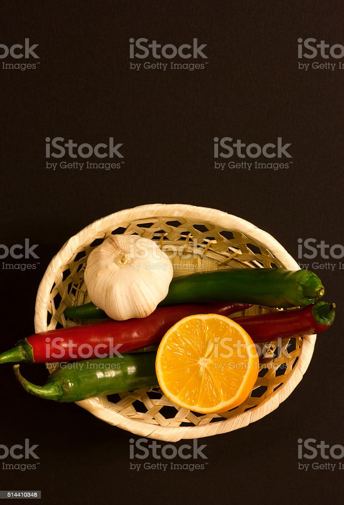 Basket with pepper and lemon stock photo