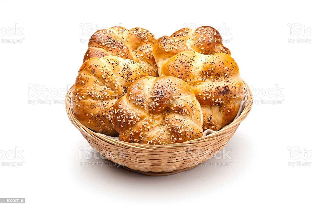 Basket with poppy seed and sesame bun of bread stock photo
