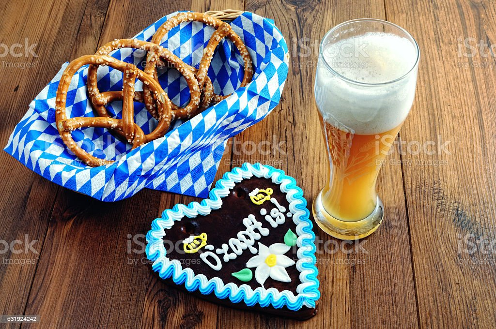basket with pretzel and gingerbread heart. beer aside stock photo