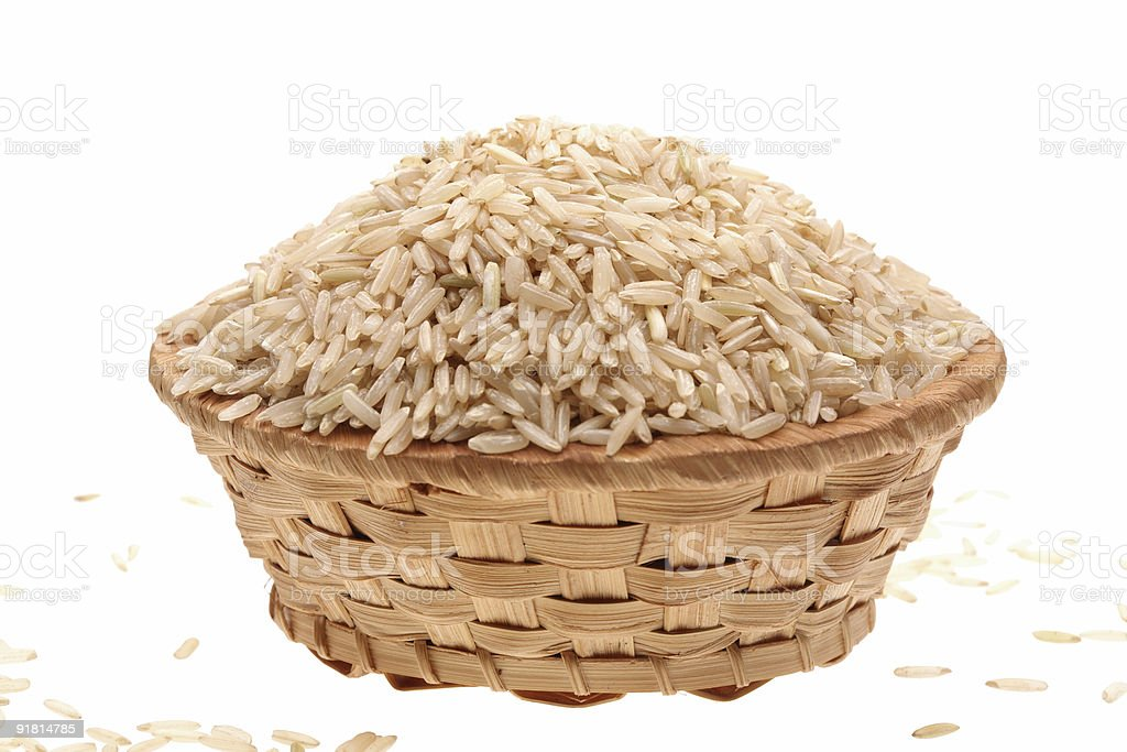 Basket with rice on a white background stock photo