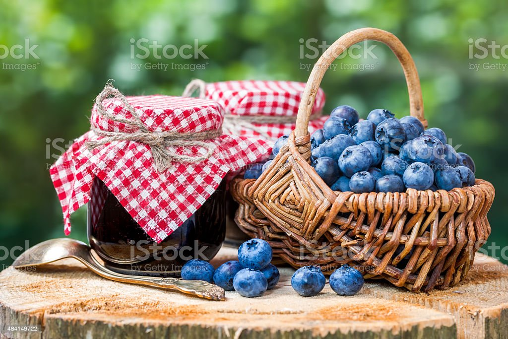 Basket with ripe blueberries and jam stock photo