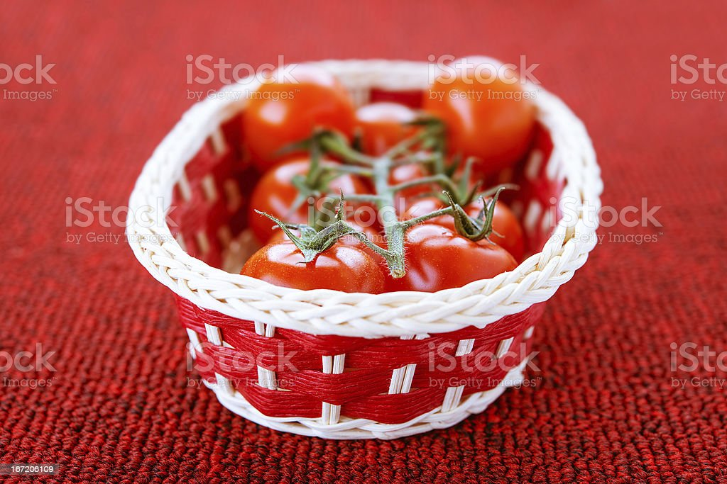 Basket with ripe tomatoes royalty-free stock photo