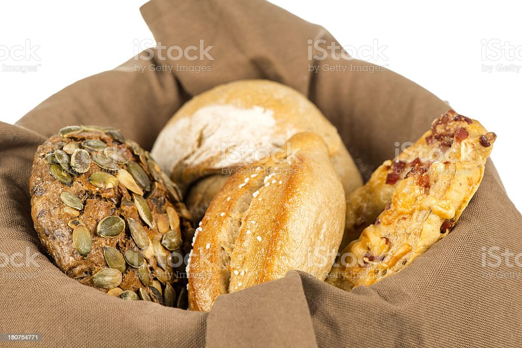 Basket with various wholgrain bread rolls royalty-free stock photo