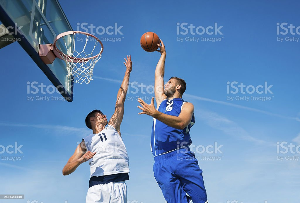 Basketball action in mid air stock photo