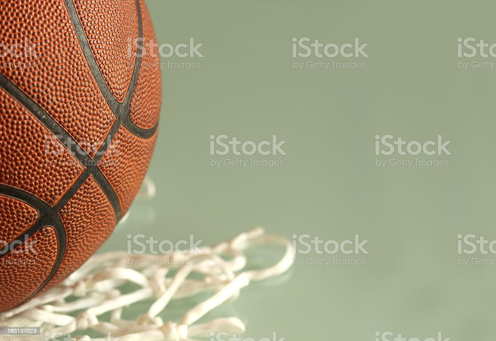 studio shot of basketball and net with copyspace