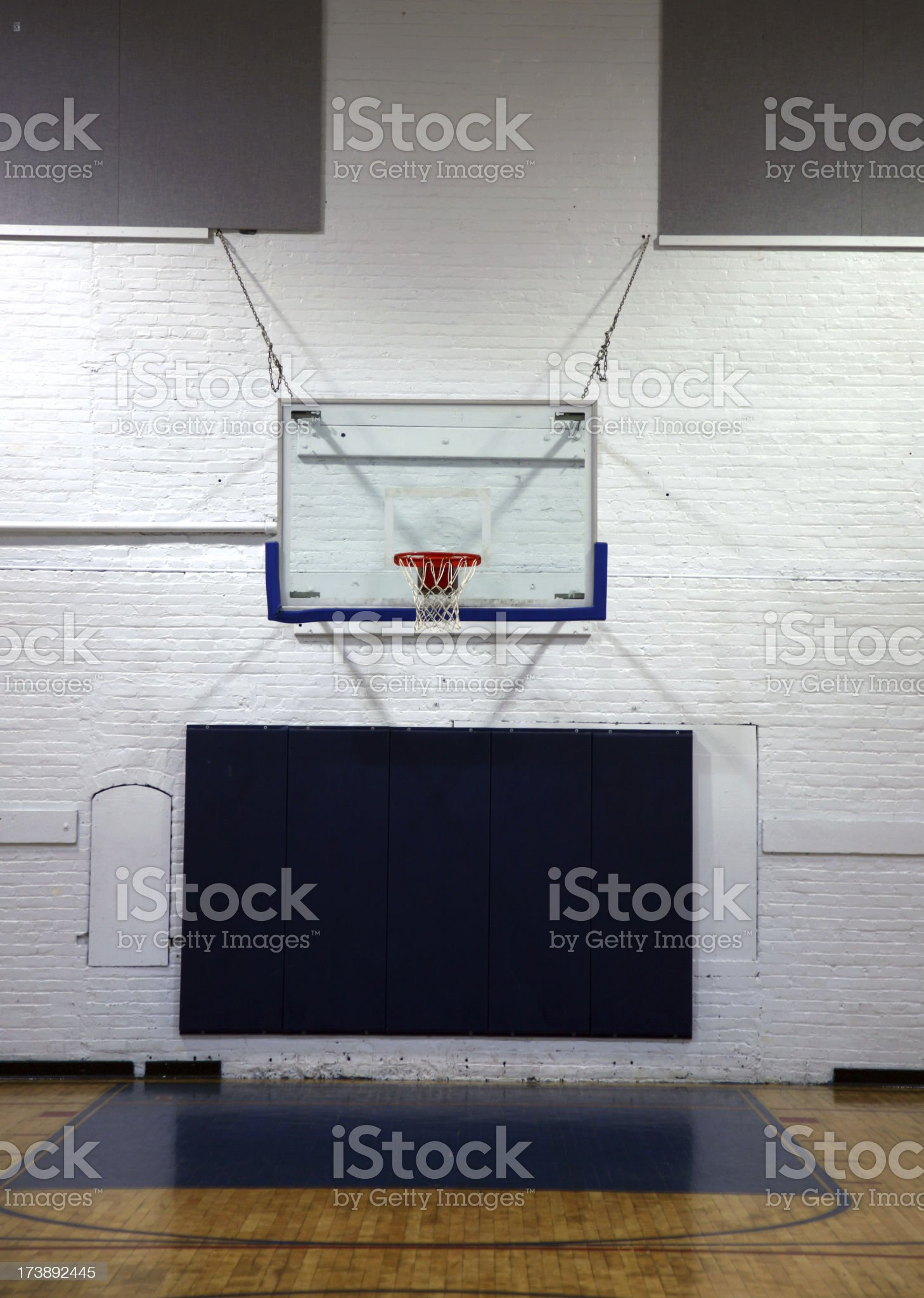 Basketball Backboard In Empty Gym royalty-free stock photo